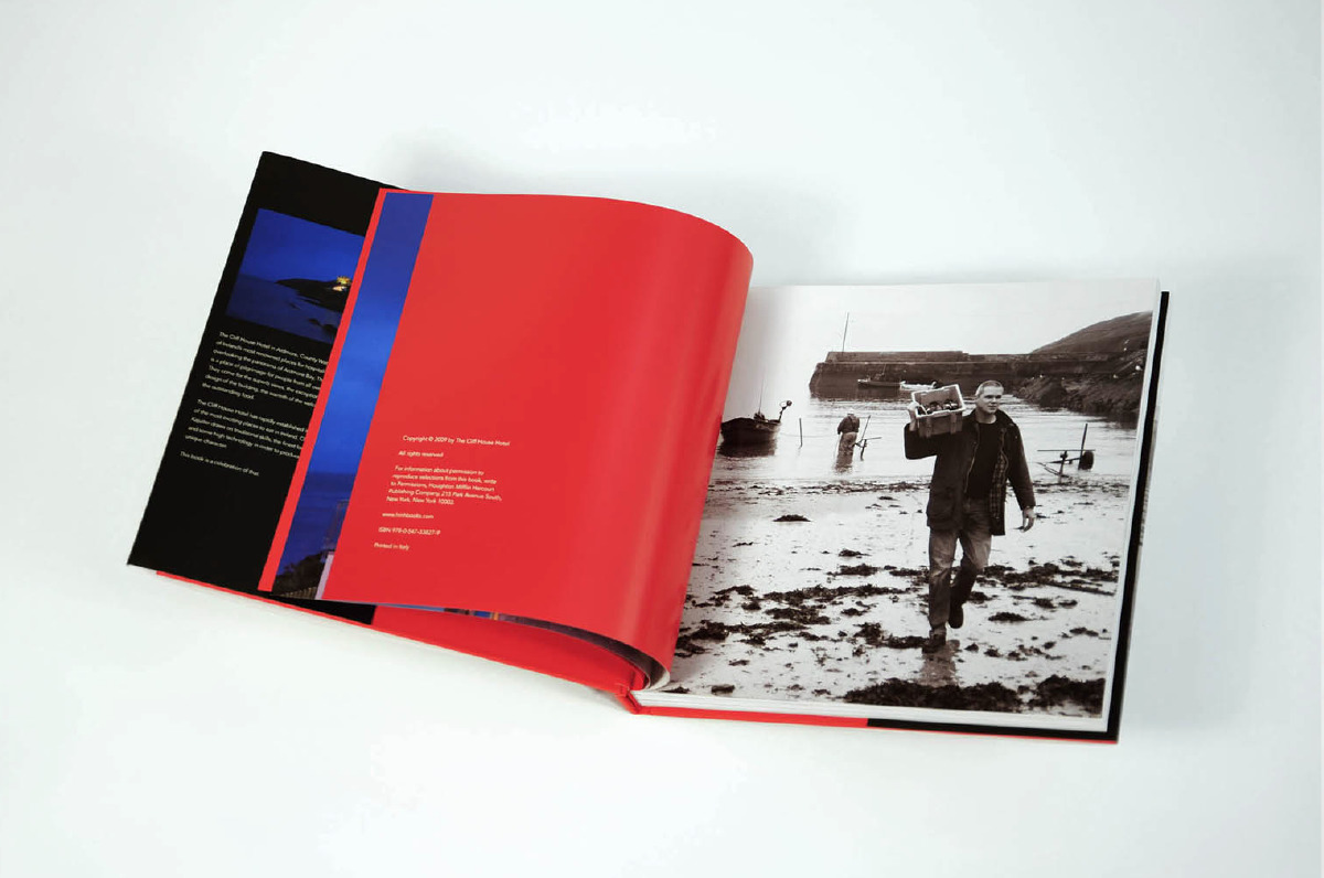 A spread with high contrast pairing a red page against black and white photography.