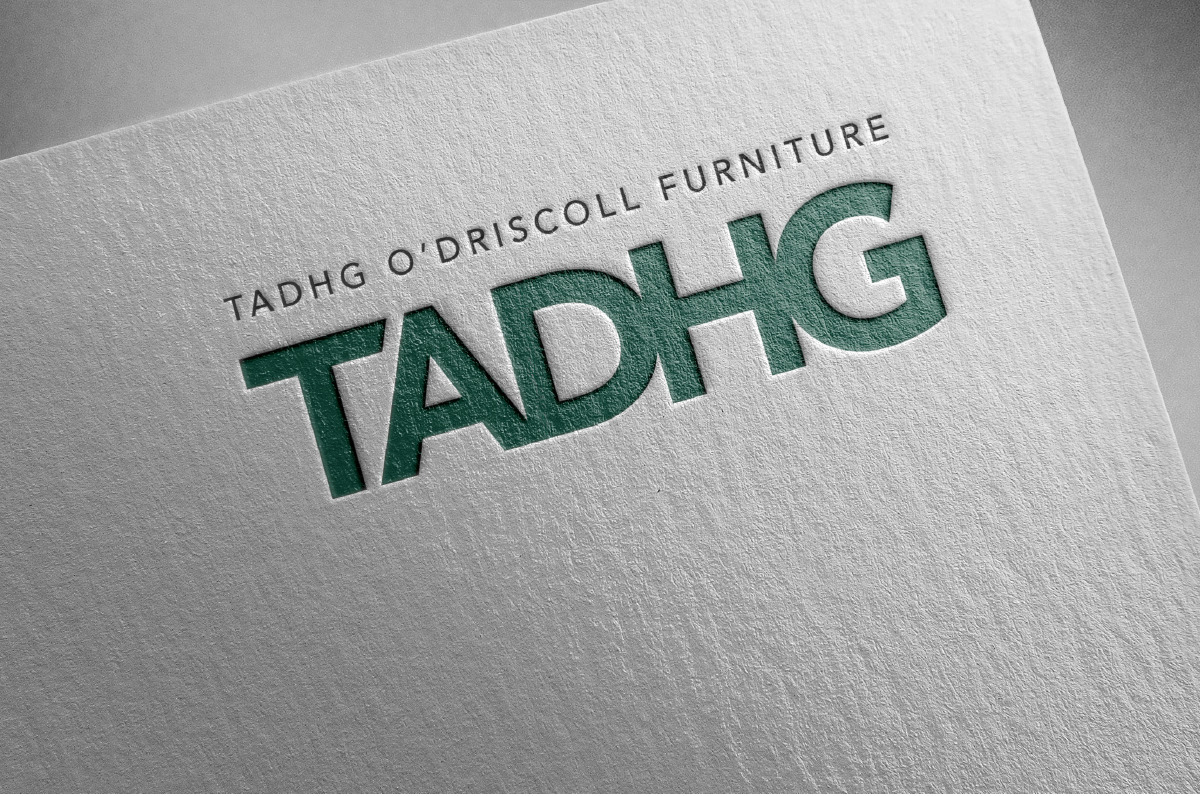 An embossed logo design to highlight the Tadhg identity