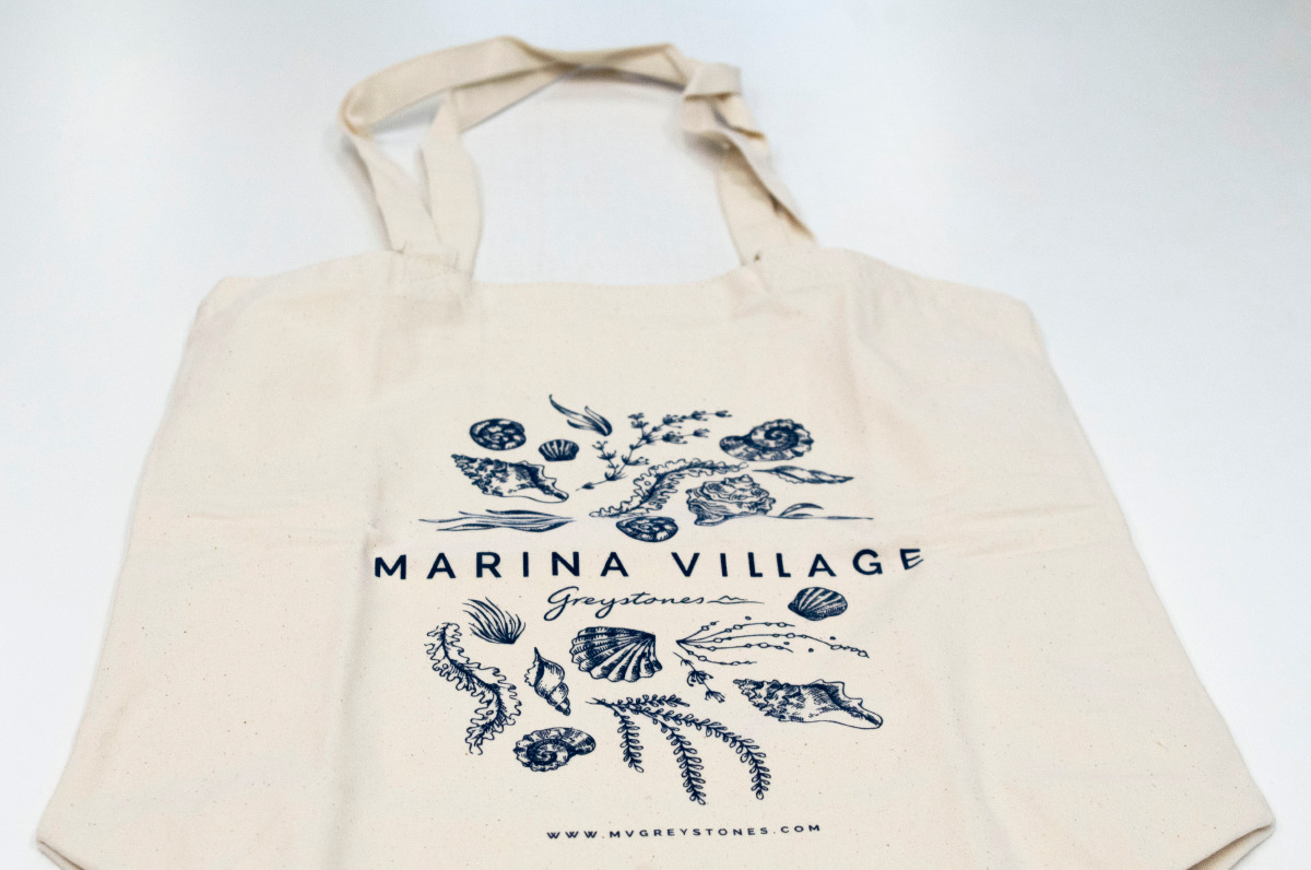 Alternate view of the tote bag displaying the Marina Village identity